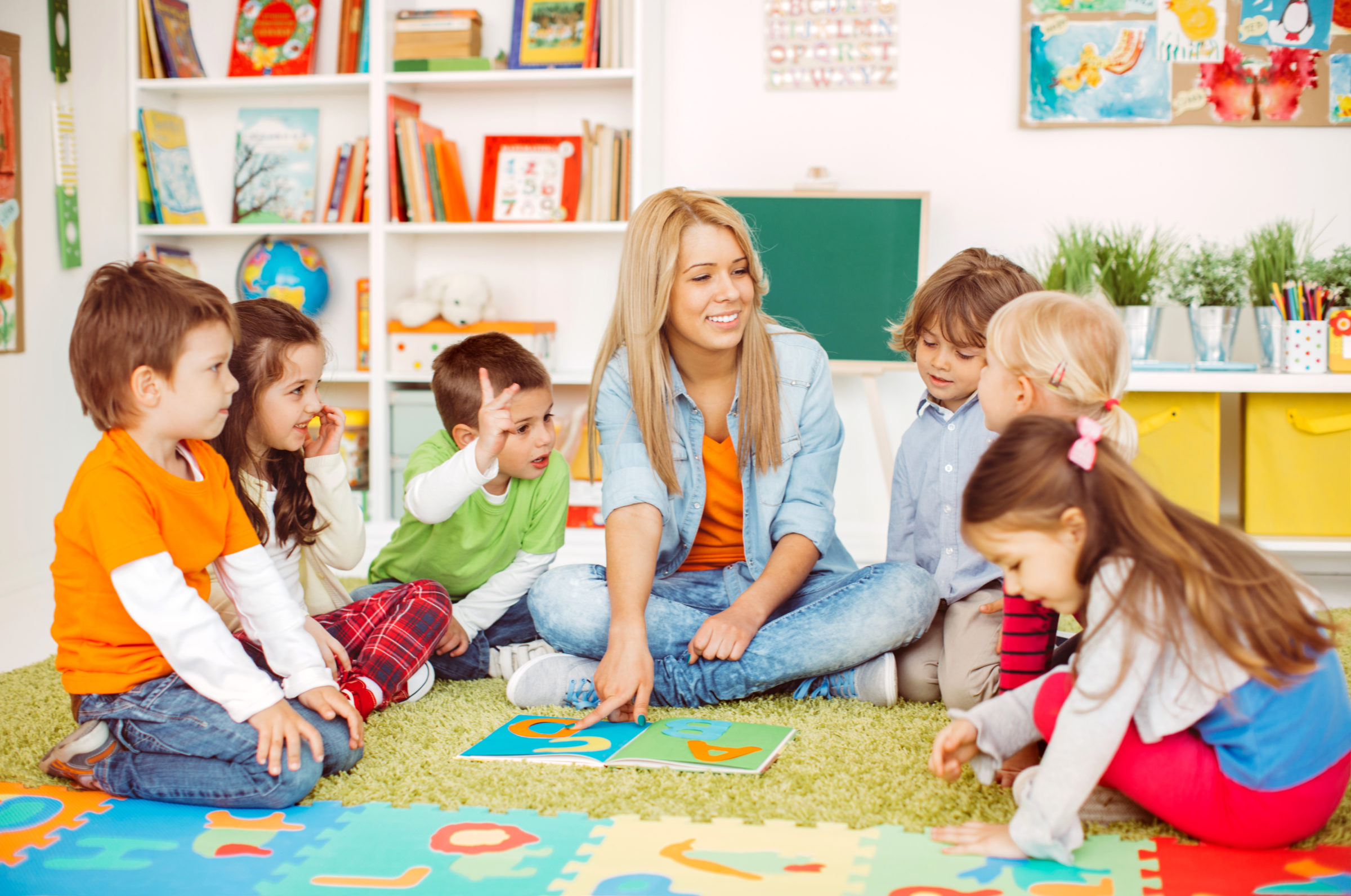 teacher with preschool children