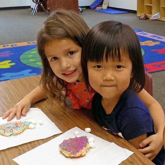 Sunshine preschool students share a snack
